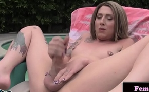 Inked trap stroking her cock outdoors